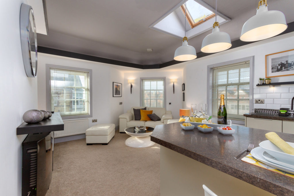 Open plan lounge and kitchen overlooking St Anne's square