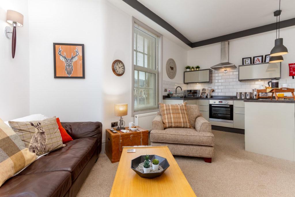 Open plan lounge-kitchen area