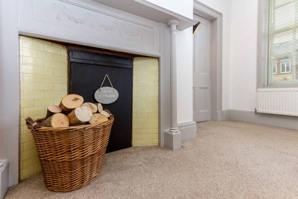 Original feature fireplace in lounge