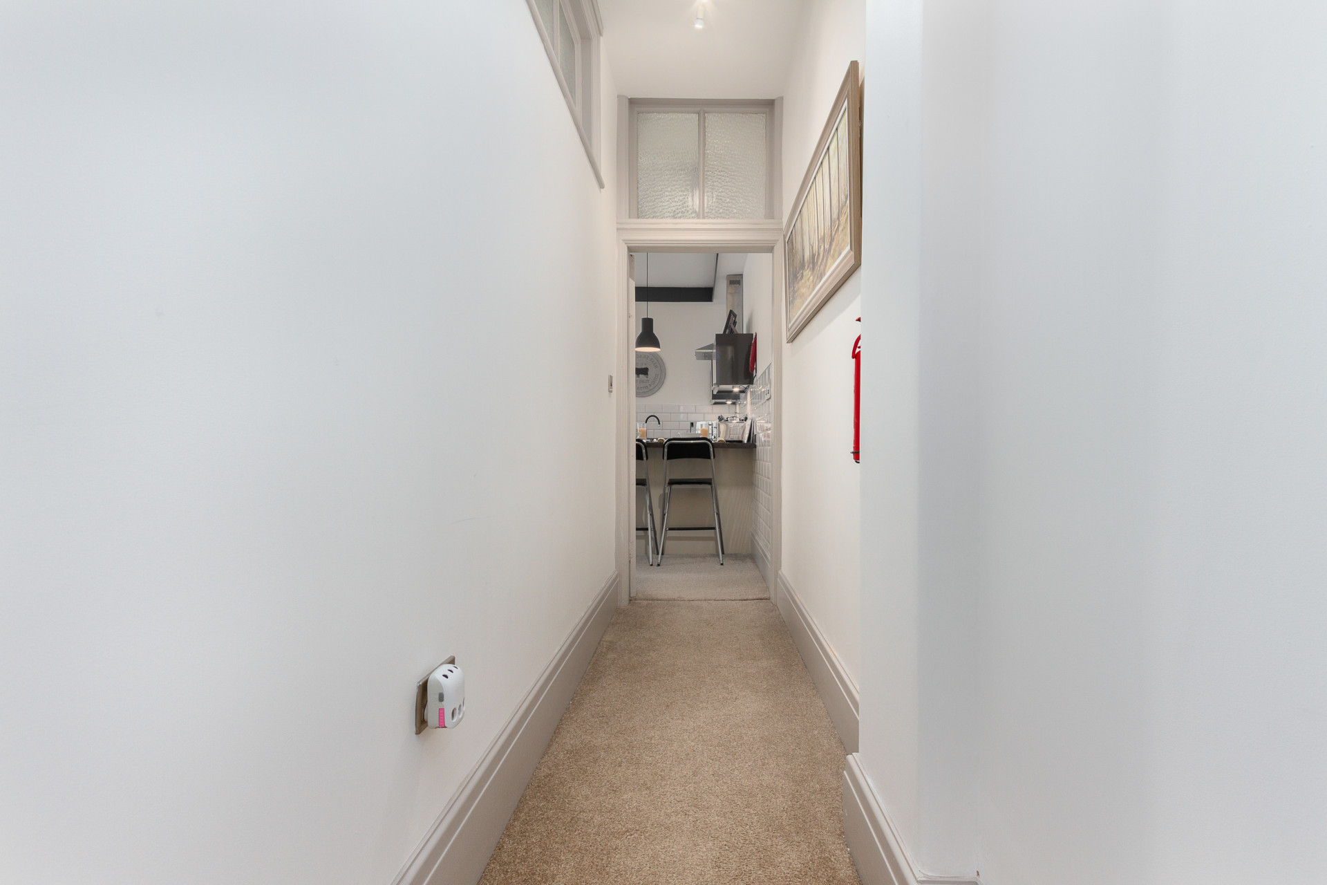 Internal hallway leading to the kitchen
