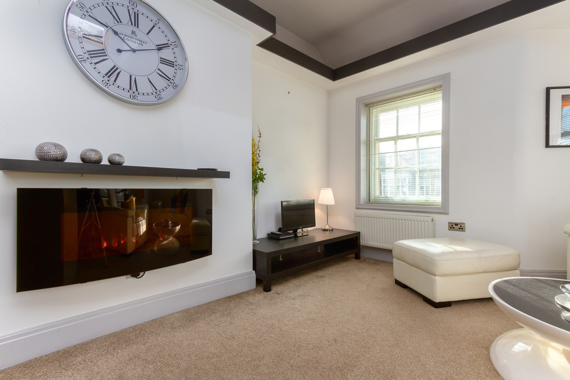 Lounge with TV and fireplace