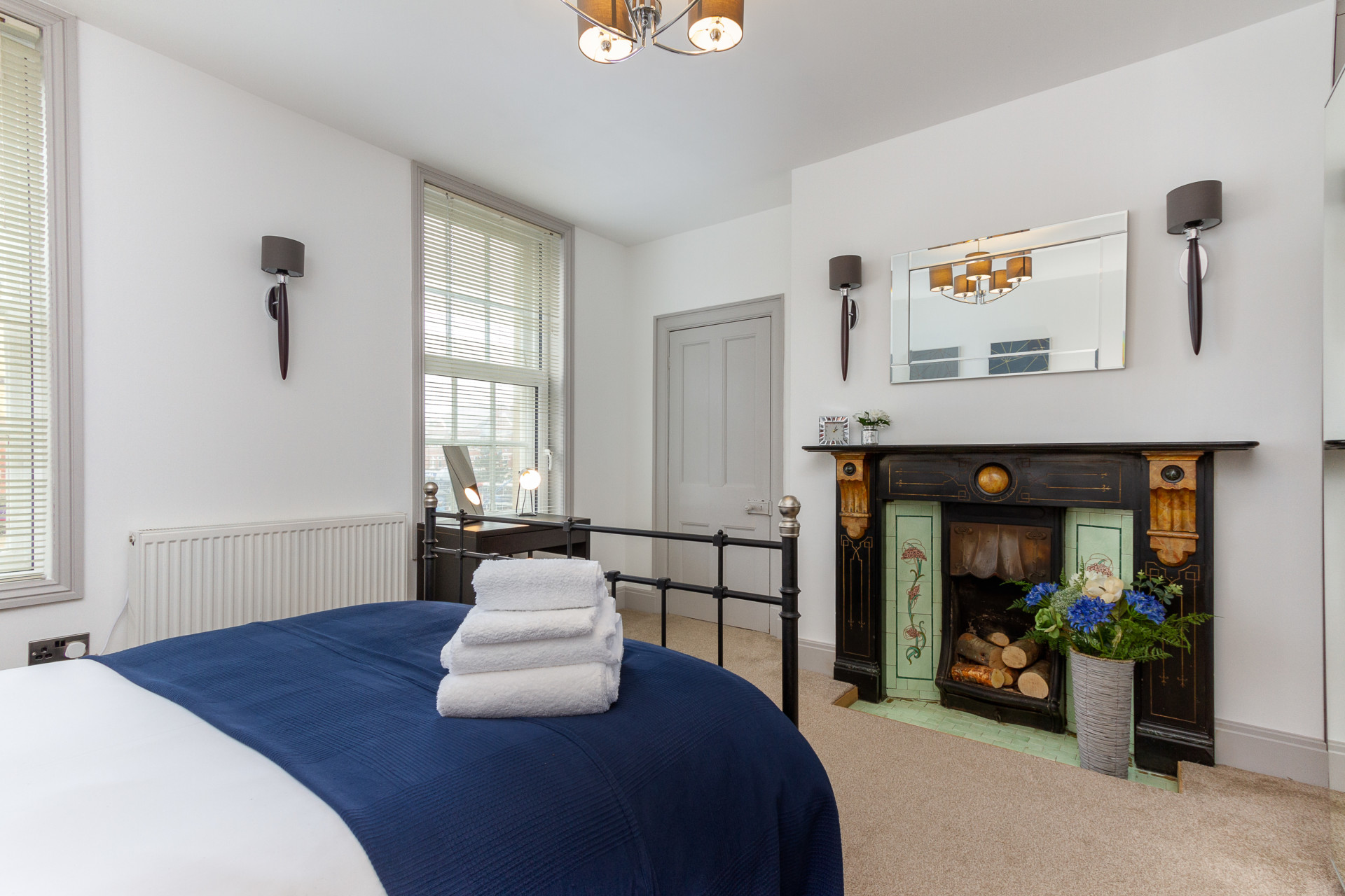 Master bedroom with original feature fireplace