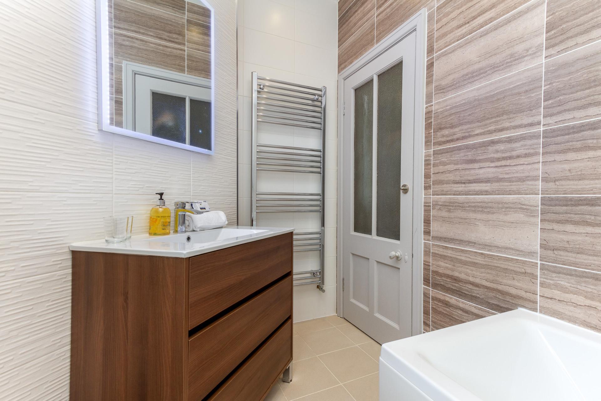 Modern bathroom with illuminated mirror